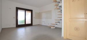 Appartamento su due livelli con giardino privato